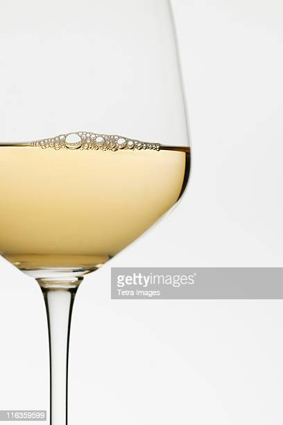 close up of glass of white wine on white background - white wine stock pictures, royalty-free photos & images