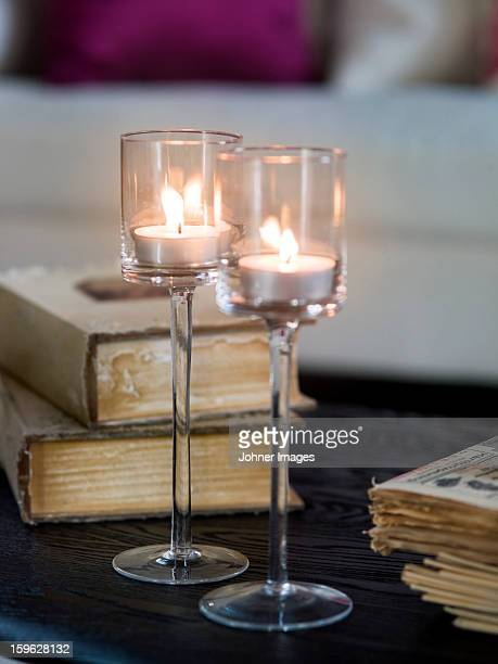 Close up of glass with tea lights on table