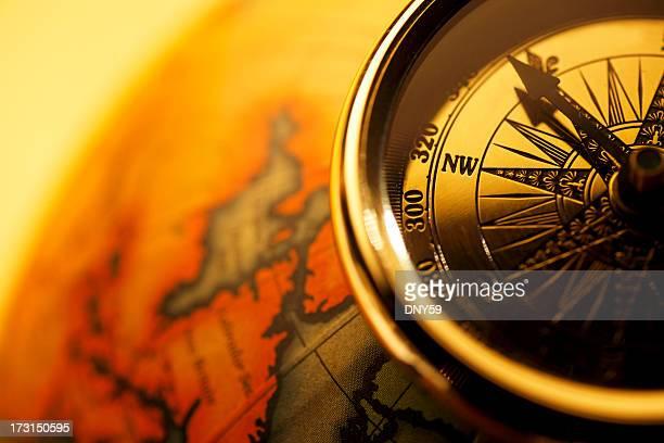 Close up of globe sitting on antique globe