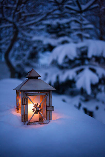 Close Up Of Glowing Lantern In Snow Wall Art