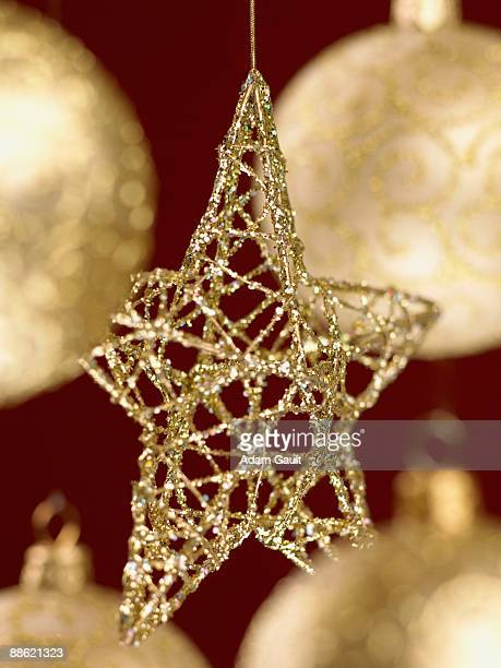 Close up of gold Christmas ornaments