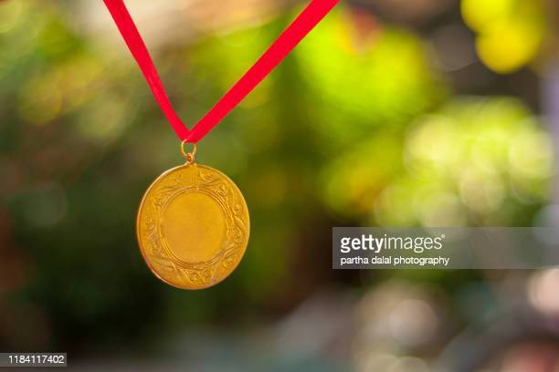 close up of gold medal - ceremony stock pictures, royalty-free photos & images