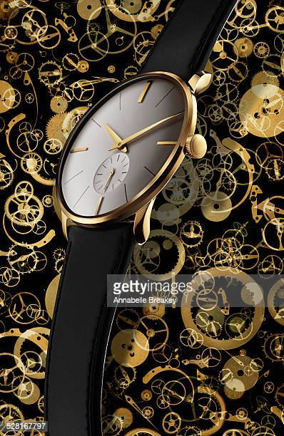 Close Up of Gold Watch on Clockwork Background