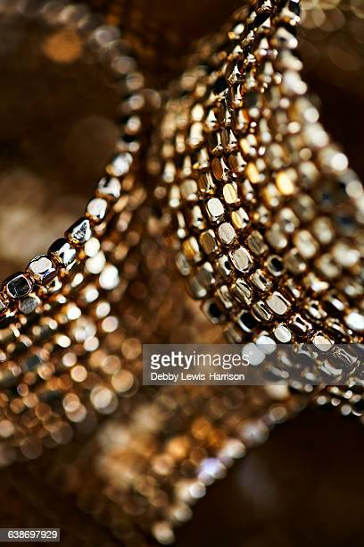 Close up of golden bangles
