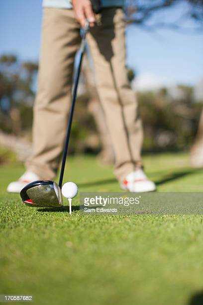 close up of golf club about to hit golf ball - sam's club stock pictures, royalty-free photos & images