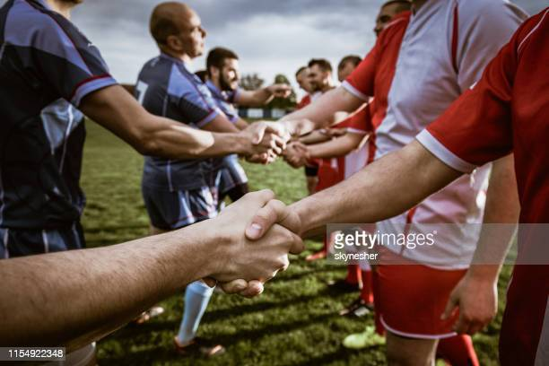 close up of good sportsmanship on the field. - rugby sport stock pictures, royalty-free photos & images