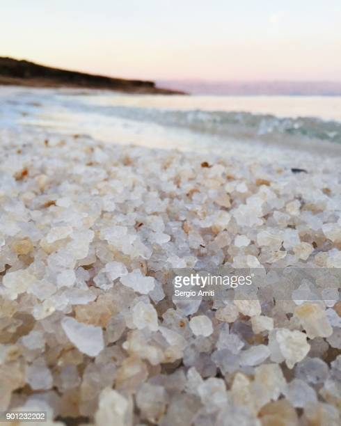 Close up of grains of salt on the Jordanian shore of the Dead Sea at sunrise