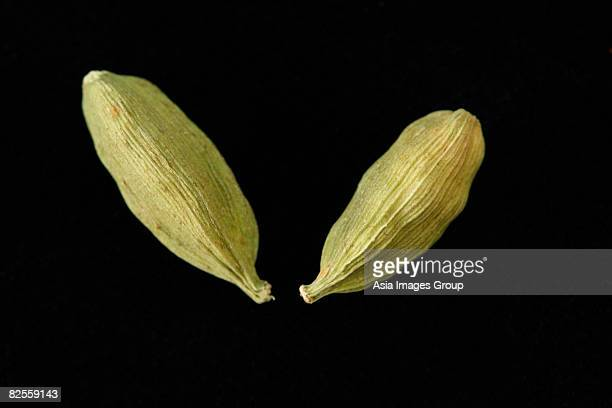 close up of green cardamom seeds - cardamom stock photos and pictures