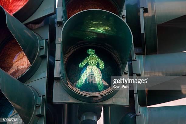 close up of green light man cross walk indicator