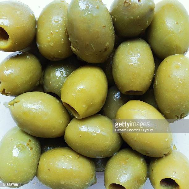 close up of green olives - green olive stock photos and pictures