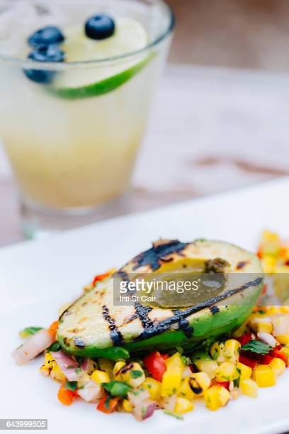 Close up of grilled avocado and salad