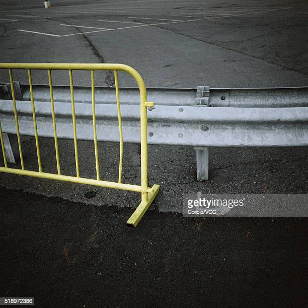 close up of guardrail and metal barrier in parking lot - vcg stock pictures, royalty-free photos & images