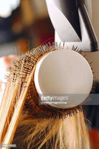 Close up of hair being brushed and dried with hair dryer