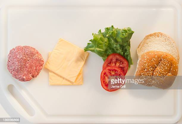 Close up of hamburger ingredients in row on tray