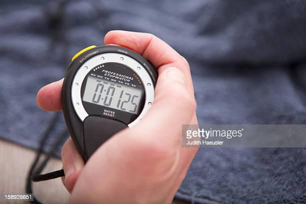 close up of hand holding stopwatch - ampulheta imagens e fotografias de stock
