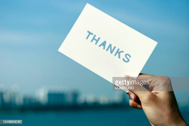 close up of hand holding thanks card - thanks quotes stock pictures, royalty-free photos & images