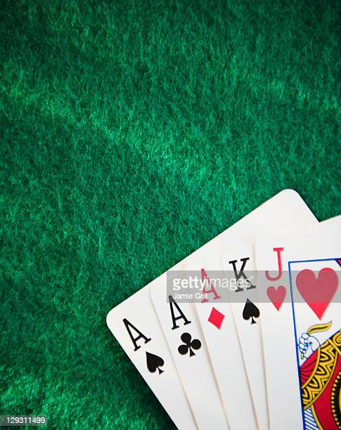 close up of hand of cards on green felt - hand of cards stock photos and pictures