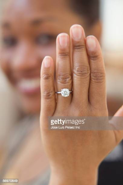 close up of hand with engagement ring - black women engagement rings stock pictures, royalty-free photos & images