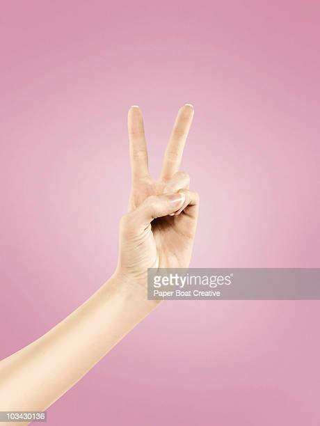 Close up of hand with the Peace symbol