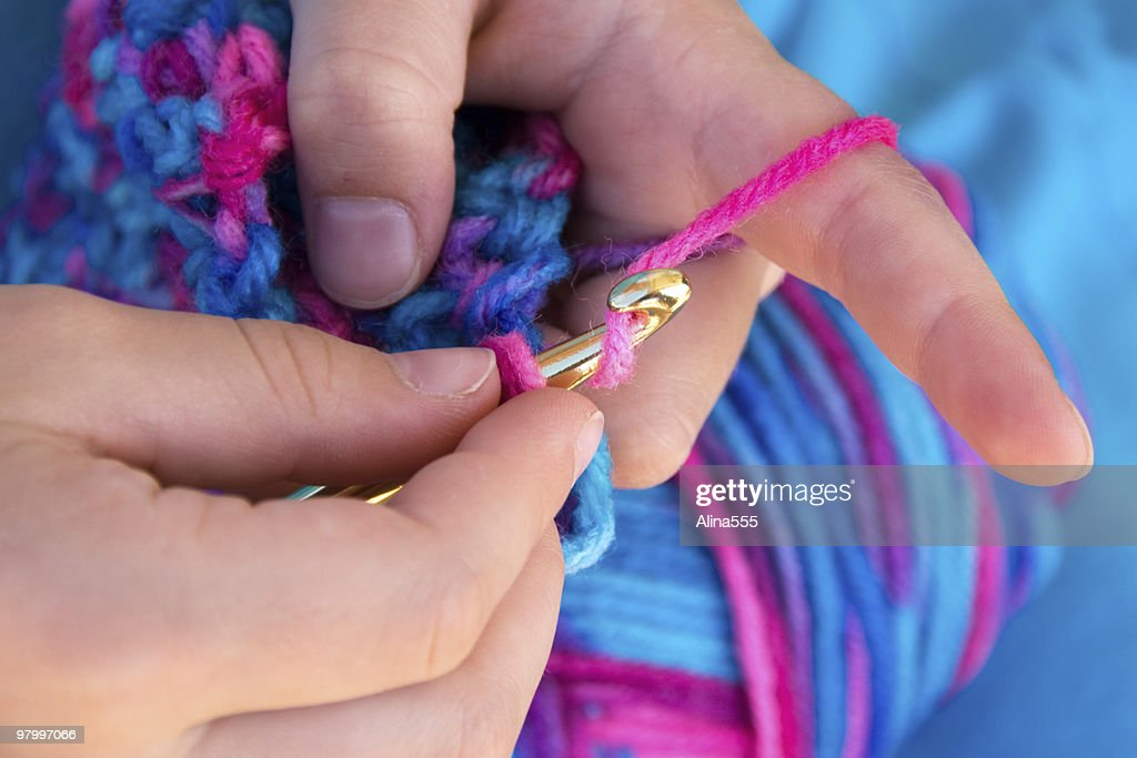 Close up of hands crocheting a blanket : Stock Photo