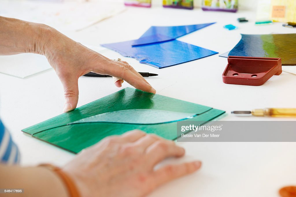 Close up of hands fitting glass panel design. : Stock Photo
