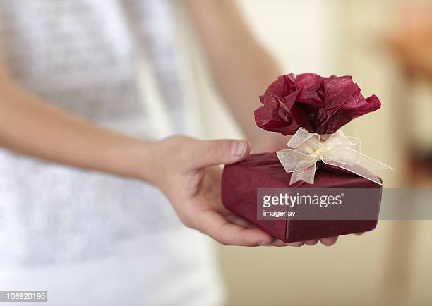 Close up of hands holding a gift