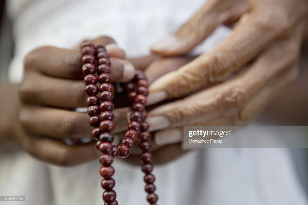 Close up of hands holding beads : ストックフォト