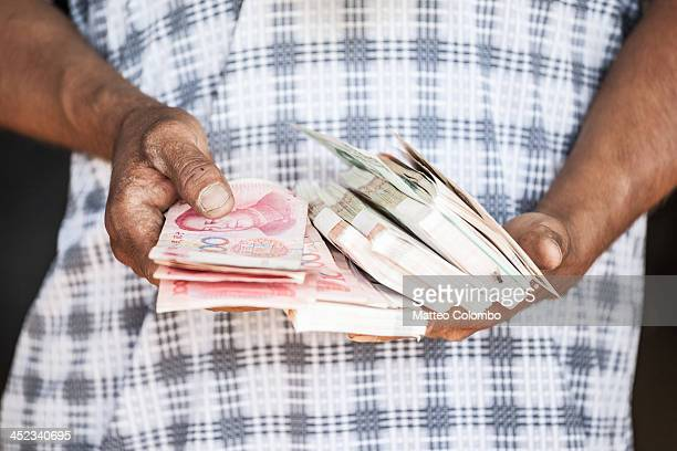 Close up of hands holding chinese money, China