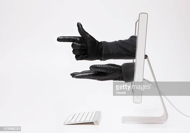 close up of hands in black gloves emerging through monitor - luva preta - fotografias e filmes do acervo