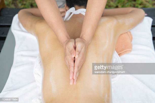 close up of hands massage therapy deep relaxation. - thai massage stockfoto's en -beelden