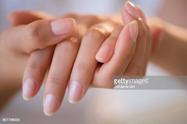Close up of hands of Hispanic woman