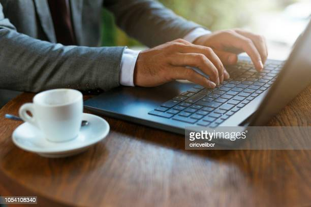 close up of hands on laptop - log on stock photos and pictures
