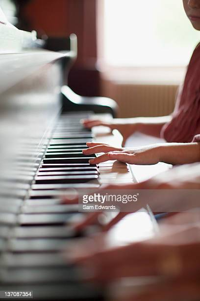 close up of hands on piano - duet stock pictures, royalty-free photos & images