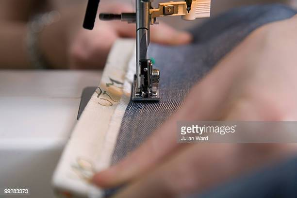 Close up of hands & sewing machine