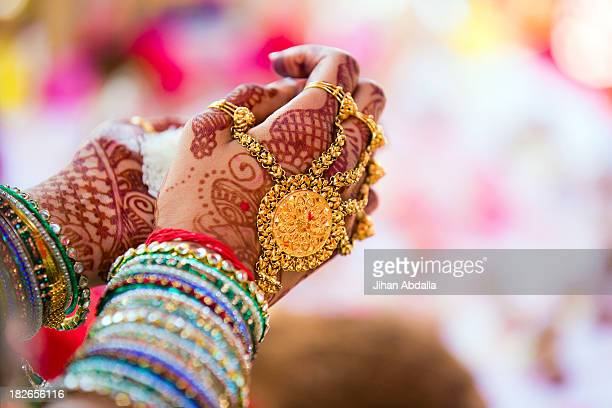 Close up of hands with intricate henna design