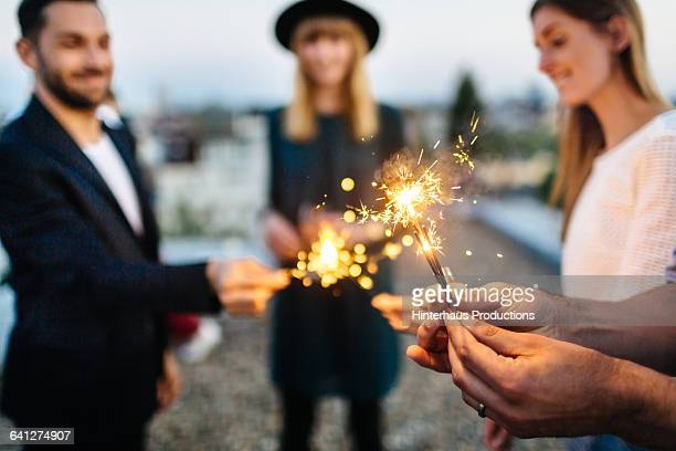 Close up of hands with sparklers