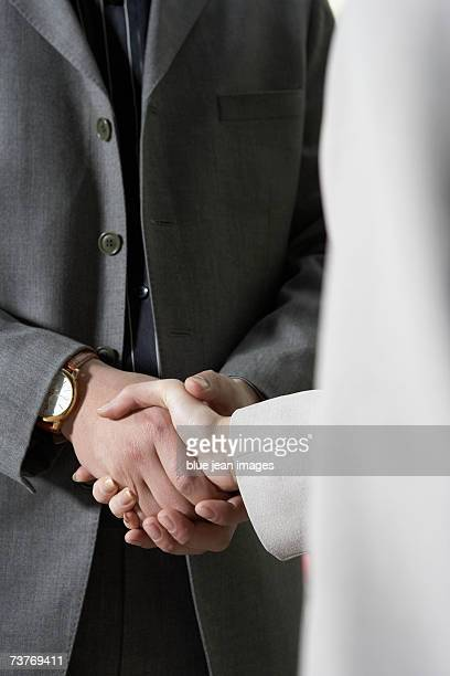 Close up of handshakes between businessman and businesswoman