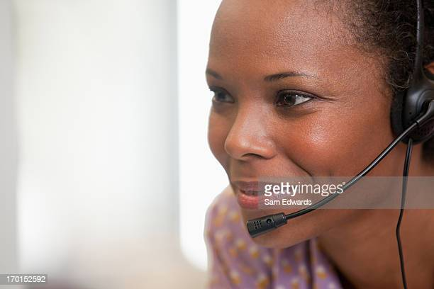 Close up of happy businesswoman using headset