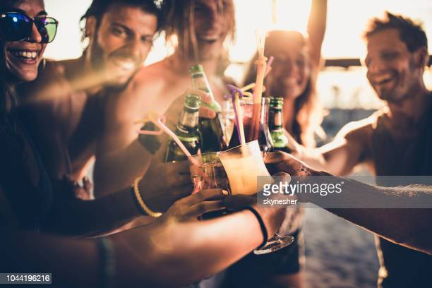 close up of happy friends toasting with alcohol at sunset. - drink stock pictures, royalty-free photos & images