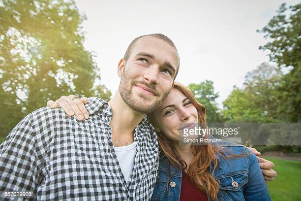 Close up of happy young couple in park