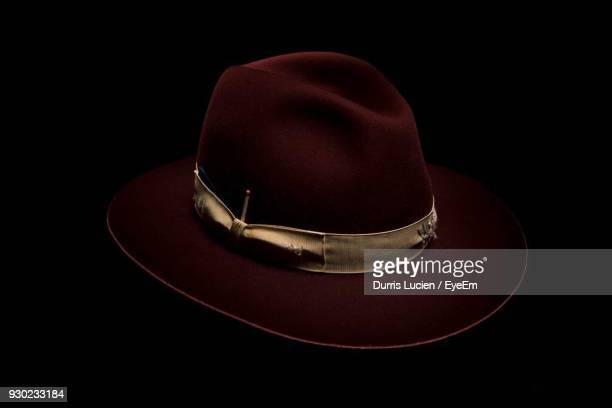 Close Up Of Hat Against Black Background