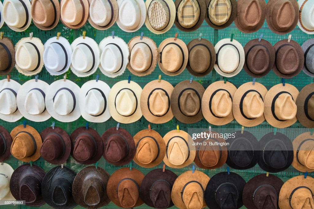 Close up of hats hanging on wall : Foto stock