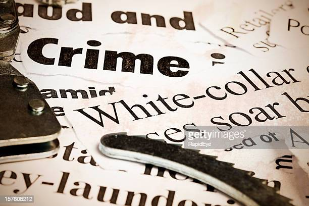 close up of headlines on financial crime with handcuffs - money laundering stock photos and pictures