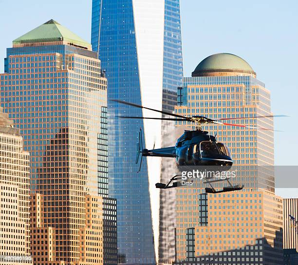 close up of helicopter and office buildings, new york, usa - helicopter stock pictures, royalty-free photos & images
