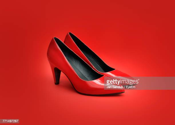 close up of high heels against red background - high heels stock pictures, royalty-free photos & images