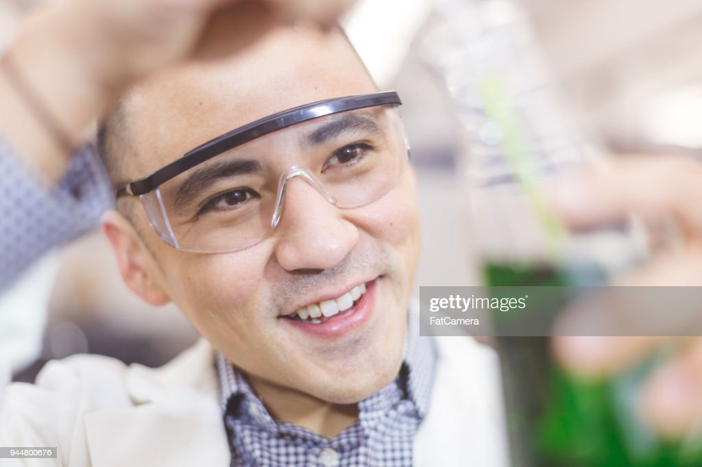 Close up of high school student in the science lab : Stock Photo