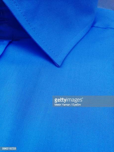 Close Up Of High Section Of Blue Shirt