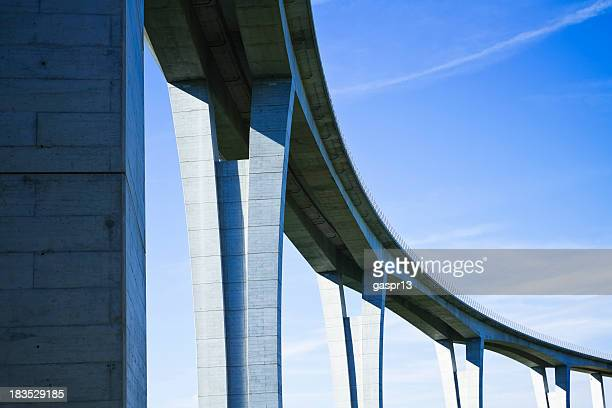 close up of highway viaduct in front of a clear blue sky - bridge stock pictures, royalty-free photos & images