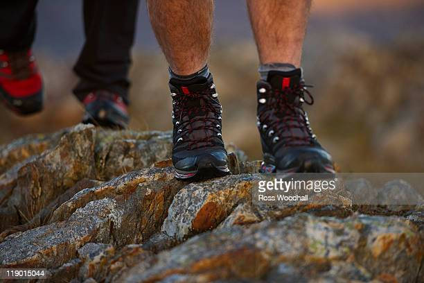Close up of hiking boots on mountainside