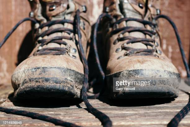close up of hiking boots outside - boot stock pictures, royalty-free photos & images